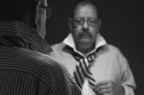 Med ränder på slipsen